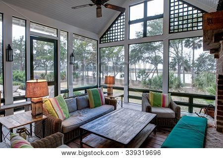 Large luxury screened in porch with view of a river.