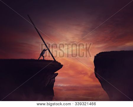 Businessman Pushing A Long Beam, Creating An Improvised Bridge To Cross The Abyss Obstacle. Cover Th