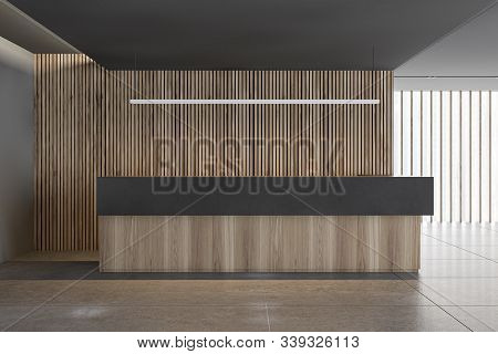 Interior Of Modern Office With Gray And Wooden Walls, Tiled Floor, Panoramic Window And Long Wooden