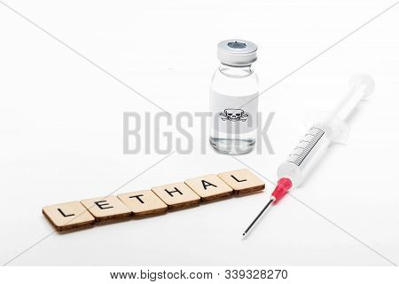 A Glass Medical Vial With A Skull And Crossbones On A White Background With A Sign Reading Lethal Al