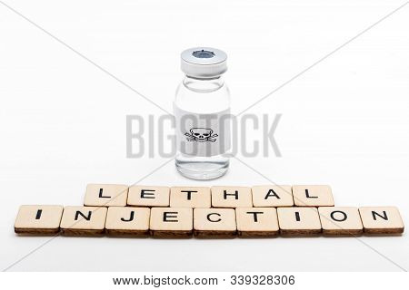 A Glass Medical Vial With A Skull And Crossbones On A White Background With A Sign Reading Lethal In