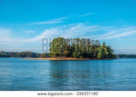 Empty Island In The Middle Of Lake Lanier With Water Surrounding A Spot For Fishing On A Vibrant Sun