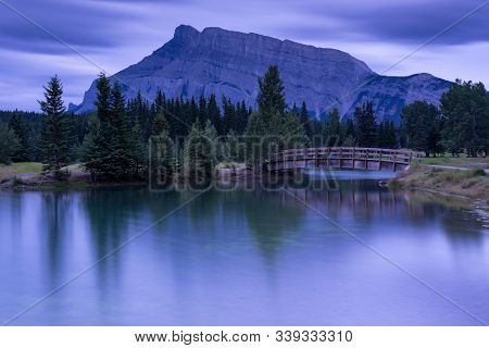 Panoramic Image Of Early Morning Mood On Cascade Ponds With Mount Rundle In The Background, Banff Na