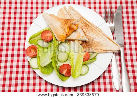 A Traditional Snack Of A Toasted Sandwich With Salad A Traditional Light Meal Of A Cheese And Bean T