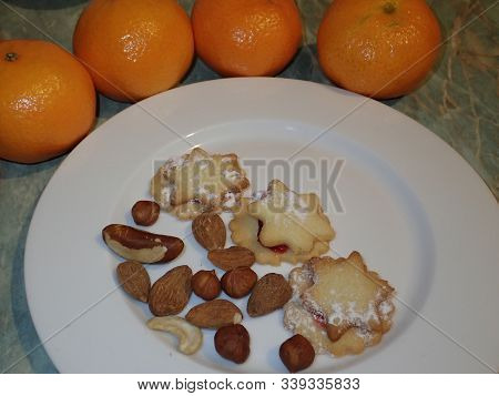 Christmass Cookies Served With Nuts And Fruit