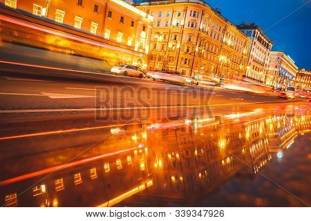 City At Night Cars Driving On The Road Blurred Headlights High Speed