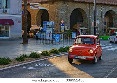 Koper, Slovenia-september 29, 2019: Vintage Red Car Zastava 750l Slowly Rides Along The Street Of Ko