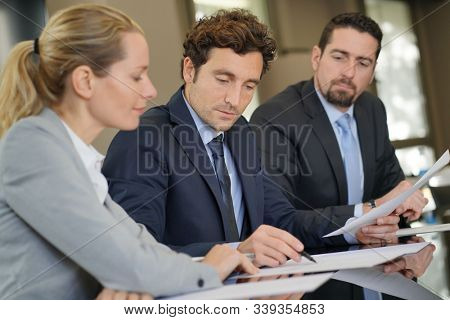 Business people negotiating commercial contract