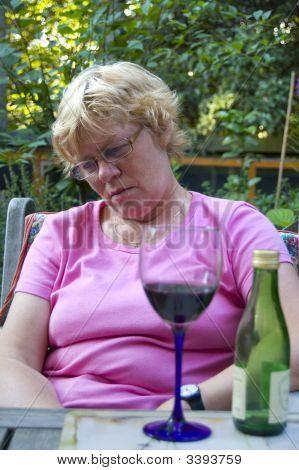 Elderly Woman Falling A Sleep After Drinking Wine