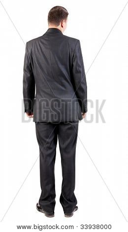 back view of business man in black suit  watching.   Businessman looks ahead.  Isolated over white background. Rear view people collection. backside view of person.