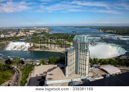 NIAGARA FALLS, ONTARIO, CANADA - MAY 27, 2016.  Niagara Falls with a view of the Americans side and Canadian  from Ontario, Canada with casino bilding seen in Niagara Falls