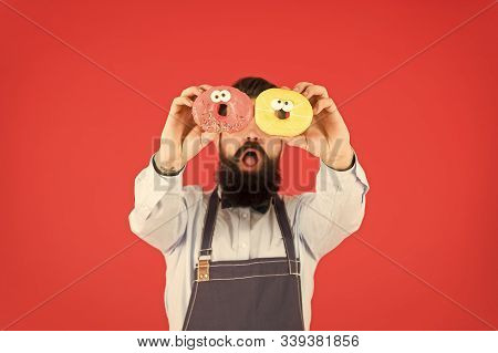 Tastiest Selection Of Doughnuts Around. Baker With Glazed Doughnuts. Bearded Man Holding Ring Doughn