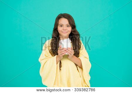 Comfy Outfit For Weekend Rest At Home. Comfy Style. Kid Wearing Soft Poncho Drinking Tea. Wellbeing
