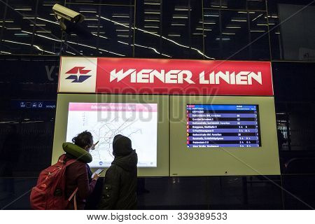 Vienna, Austria - November 6, 2019: Commuters And Passengers Looking At A Map Of Vienna Public Trans