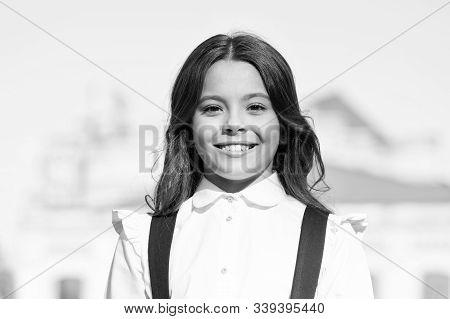 Vintage Kid Fashion And Beauty. Schoolgirl In Classy Retro Uniform. Small Happy Girl Ready To Study.