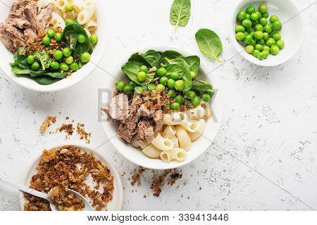Tuna Pasta Bowl Salad. With Fresh Spinach, Young Green Peas, Breadcrumbs. Top View. Flat Lay