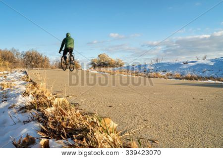 Winter or late fall commuting on a bike trail - Poudre River Trail in northern Colorado
