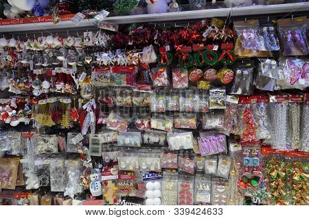 Christmas Market. Christmas Decoration Shelves Filled With Tree Ornaments, Shiny Baubles, Gift Stock