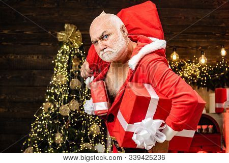 Thief Santa With Bag On Christmas Background. Thief Stole New Years Presents. Christmas Safety From