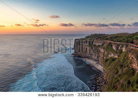 Sunset View Over The Sea And Beautiful Waves At Uluwatu Temple, Bali Island