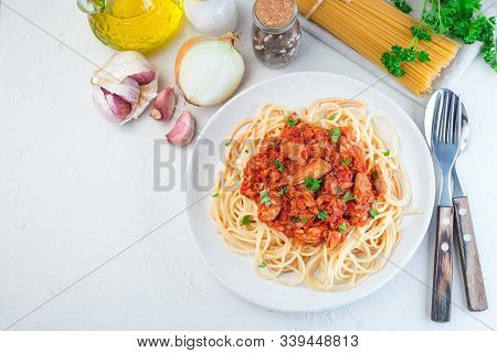 Spaghetti With Tuna And Tomato Basil Sauce Garnished With Parsley, Horizontal, Top View,  Copy Space
