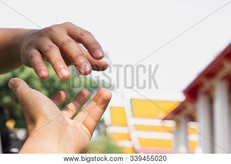 Help Concept Hands Reaching Out To Help Each Other.