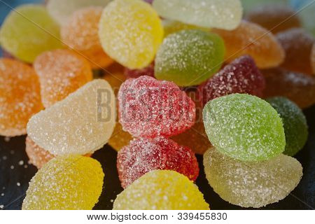 Colorful jelly candies with sugar. Close up view of fruity jelly candies as background. Sugar candies texture and background for design. poster