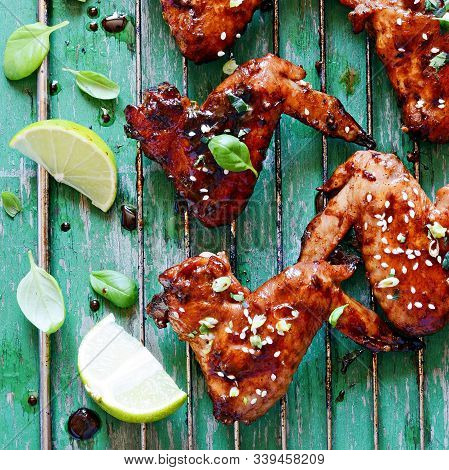 Hot Buffalo Chicken Wings With Soy Sauce Dressing Of Green Onions And Lime. Appetizing Bar Snack. Am