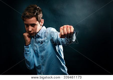 The Concept Of Domestic Violence. The Boy Folded His Fists And Defends Himself From Aggression, Stri