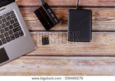 Photographers Desktop Workspace External Backup Disk Hard Drive Connected To Laptop Computer Transfe
