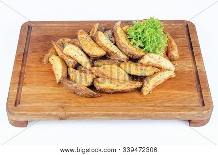 Fried Potato Wedges Or French Fries Or Chips. Home Made In Rural Style On Wooden Board. Healthy Orga