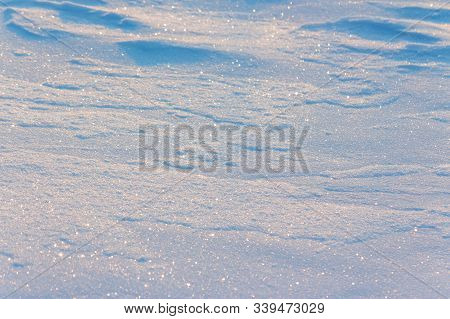 Natural Snow White Texture. Bright Winter Background. Cold Frosty Weather Condition. Shining And Gli