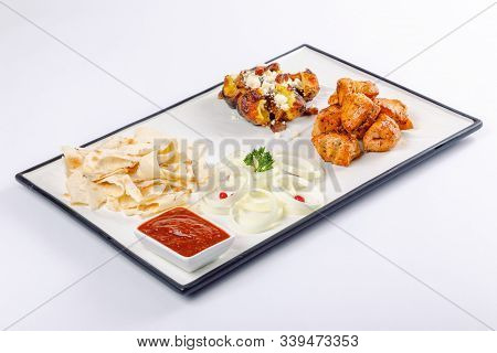 Grilled Chicken And Baked Potato With Cheese. Onion Circles And Pita Bread, Red Sauce On A White Boa