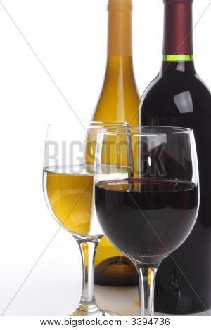 Two Wine Bottles With Glasses