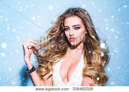 Girl In Snow. Sensual Beauty Model In Fashion Bra. Breasts With Bra. Portrait Of A Winter Blond Woma