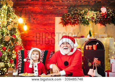 Kid And And Grandfather Writting A Christmas Letter To Santa Claus. Christmas Helper Child Writing L