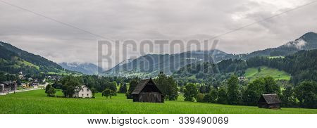 Natural Rural Landscape With Traditional Wooden Houses In The Valley Of Enns River At The Foot Of Ro