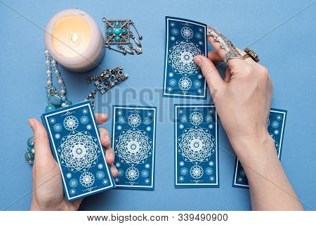 Fortune Teller Holding A Tarot Cards In The Hands.