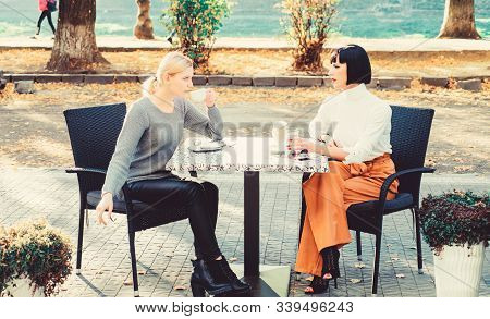 Togetherness And Female Friendship. Trust Her. Girls Friends Drink Coffee And Enjoy Talk. True Frien