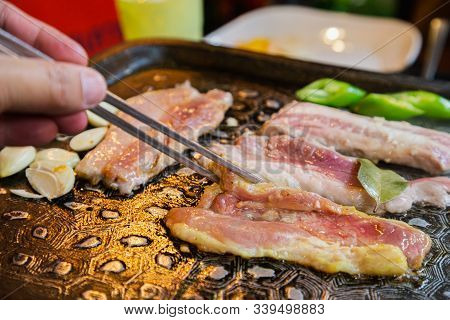 Korean Bbq Raw Beef On The Grill And Vegetables With Chopstick. Yakiniku Korean Food. Korean Roasted