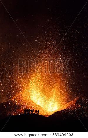 People Watching Lava Fountains And Explosions With Molten Fire During The Eruption Of The Eyjafjalla