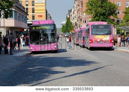 Orebro, Sweden - May 22, 2019: Violet City Busses At The Jarntorget Square Bus Stop.