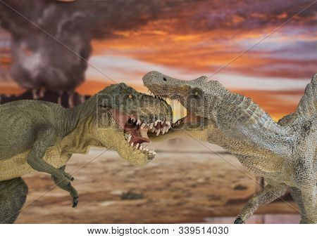 Tyrannosaurus Rex Fighting With Spinosaurus In The Foreground With Erupting Volcano In The Backgroun
