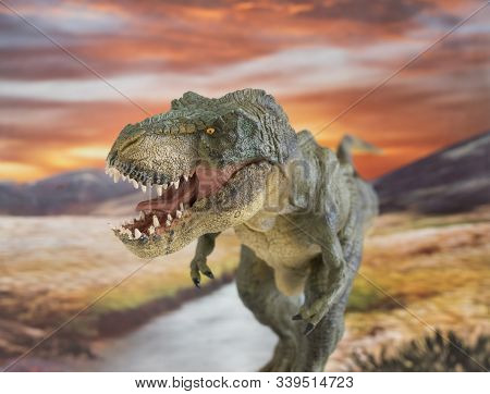 Portrait Of Walking And Dangerous Tyrannosaurus Rex With River In The Background. Front View