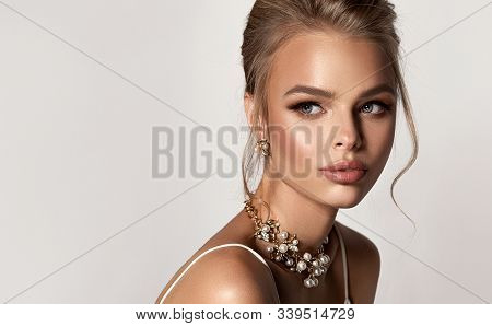 Beautiful Girl With Set Jewelry .   Woman In A Necklace And Earrings . Beauty  ,   Cosmetology And A
