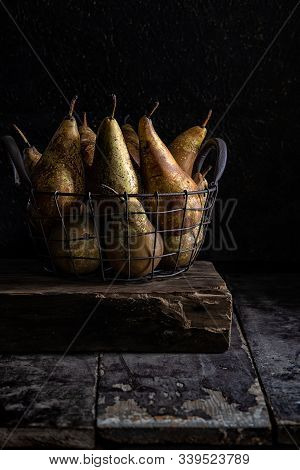 Basket Of Pears On An Old Table