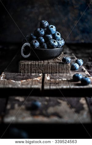 Bowl Of Blueberries On Old Wooden Planks