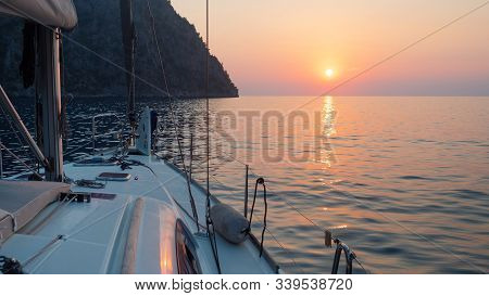 Meet The Sunset In The Bay On Board The Yacht, A Romantic Evening At Sea. Boat Trip On A Yacht Under