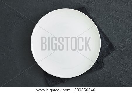 Empty White Plate On Black Table And Napkin. Food Background For Menu, Recipe. Table Setting. Flatla