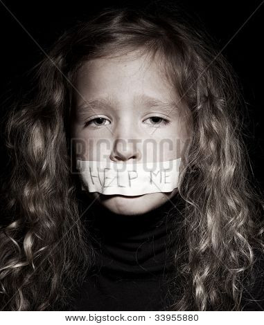 Little child with taped mouth, begging for help. Sad, abuse girl. Violence, despair.